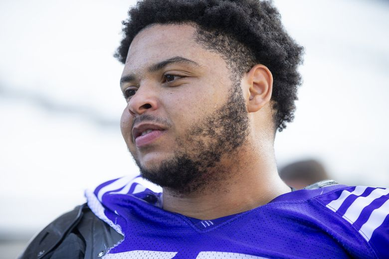 Huskies offensive lineman Nick Harris talks with reporters after the University of Washington holds day five of football training camp at Husky Stadium Tuesday August 6, 2019. (Bettina Hansen / The Seattle Times)
