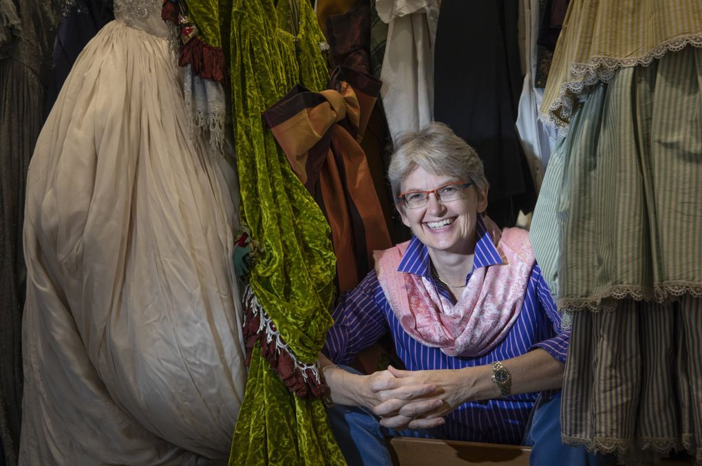 Christina Scheppelmann, Seattle Opera's new general director, is surrounded by costumes in the costume shop at Seattle Opera headquarters. (Ellen M. Banner / The Seattle Times)