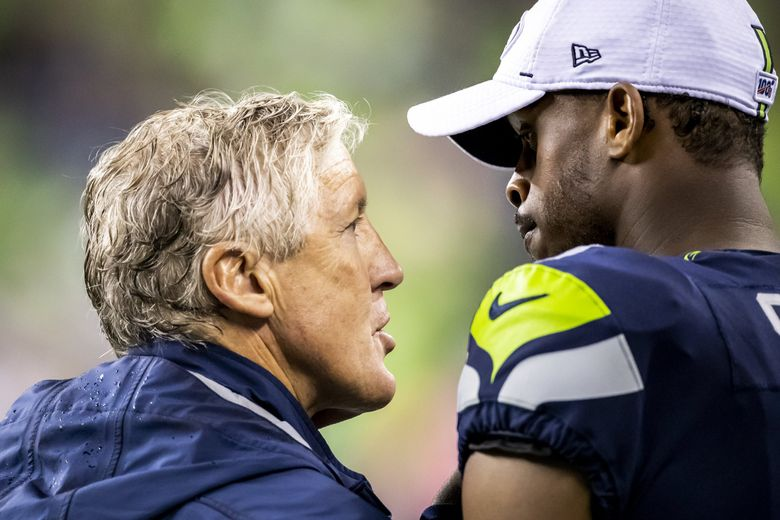 Seahawks head coach Pete Carroll talks with quarterback Geno Smith on the sidelines as the Seattle Seahawks take on the Oakland Raiders at CenturyLink Field in Seattle Thursday August 29, 2019 for their fourth preseason game. (Dean Rutz / The Seattle Times)