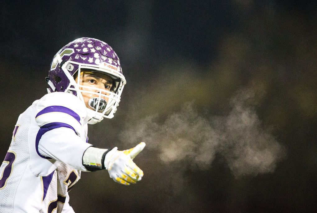 Lake Stevens' Kasen Kinchen gestures to his team as the Woodinville Falcons take on the Lake Stevens Vikings during the state football semifinals last year. (Rebekah Welch / The Seattle Times)