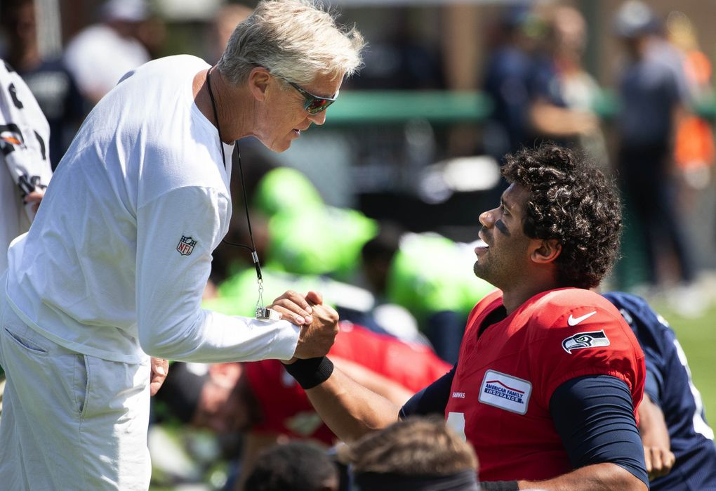 Pete Carroll and Russell Wilson talk before Saturday's practice at Pop Keeney Stadium in Bothell.The Seattle Seahawks held a public practice at Pop Keeney Stadium in Bothell, WA, Saturday August 3, 2019. (Dean Rutz / The Seattle Times)