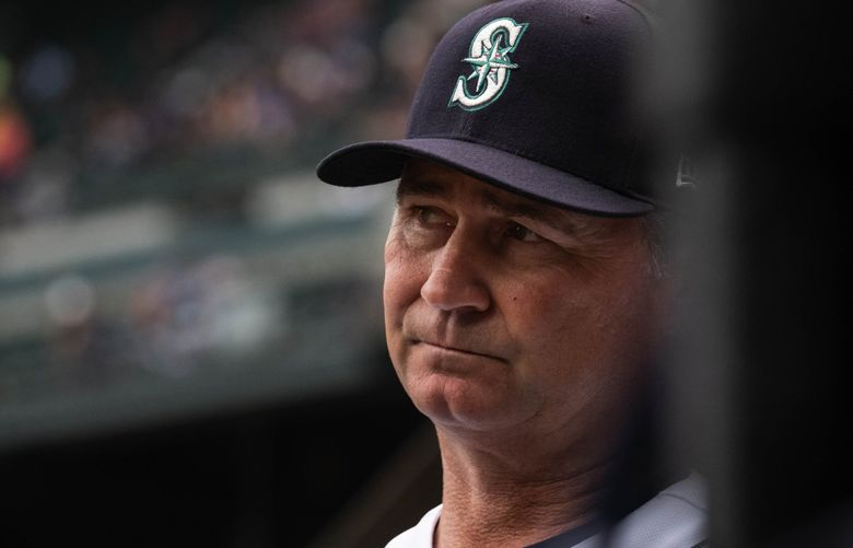Mariners manager Scott Servais watches his team from the dugout against the Detroit Tigers on July 27 at T-Mobile Park. (Dean Rutz / The Seattle Times)