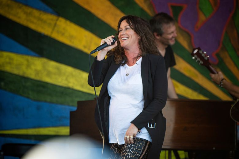 FILE – In this April 25, 2019, file photo, Alanis Morissette performs at the New Orleans Jazz and Heritage Festival in New Orleans. The Morissette-Treadway house has a new addition: Morissette has given birth to her third child, a son. The Grammy winner announced the arrival of her son, Winter Mercy, on Instagram on Monday, Aug. 12. The post included a black-and-white photo of the boy snuggled peacefully in a blanket. (Photo by Amy Harris/Invision/AP, File)