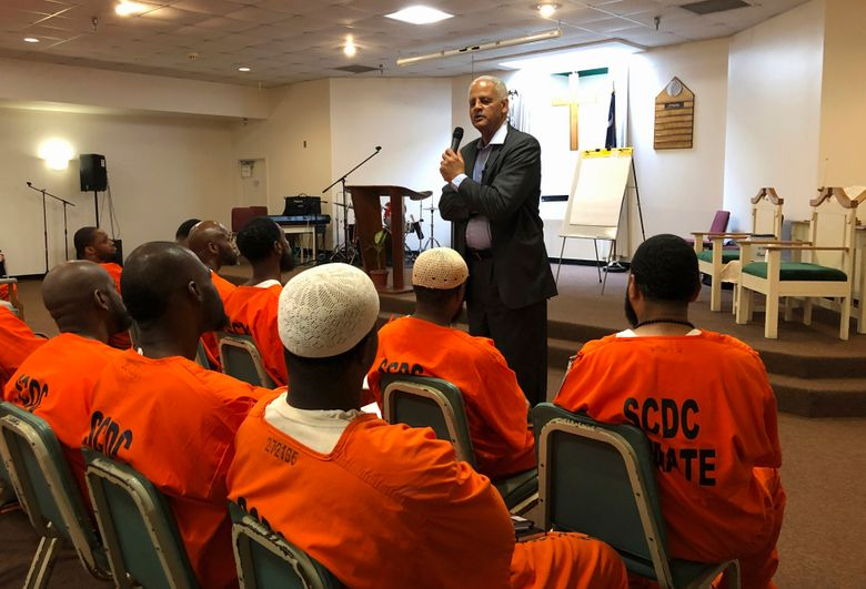 Educator, author and businessman Stedman Graham speaks to inmates at Lee Correctional Institution in Bishopville, S.C. on Wednesday, Aug. 28, 2019. Graham, the longtime partner of Oprah Winfrey, spoke about leadership and finding your purpose at a special Academy of Hope program at the prison where seven inmates were killed in an April 2018 riot. (AP Photo/Jeffrey Collins)