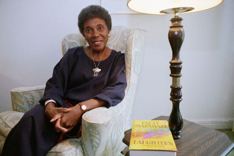 """FILE – In this Nov. 22, 1991 file photo, author Paule Marshall poses during an interview, in New York.  The acclaimed fiction writer has died at 90. Marshall's son, Evan K. Marshall, told The Associated Press that she died Monday, Aug. 12, 2019 in Richmond, Va.    Marshall was an exuberant and sharpened storyteller who drew upon classic and vernacular literature and her mother's kitchen conversations for such fiction as """"Brown Girl, Brownstones,"""" """"Daughters"""" and """"Praisesong for the Widow.""""  (AP Photo, File)"""