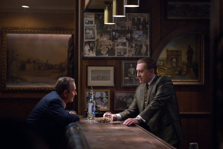 """This image released by Netflix shows Joe Pesci, left, and Robert De Niro in a scene from """"The Irishman.""""   Netflix said Tuesday, Aug. 27, 2019  that """"The Irishman"""" will open theatrically Nov. 1 and begin streaming on Nov. 27. (Niko Tavernise/Netflix via AP)"""
