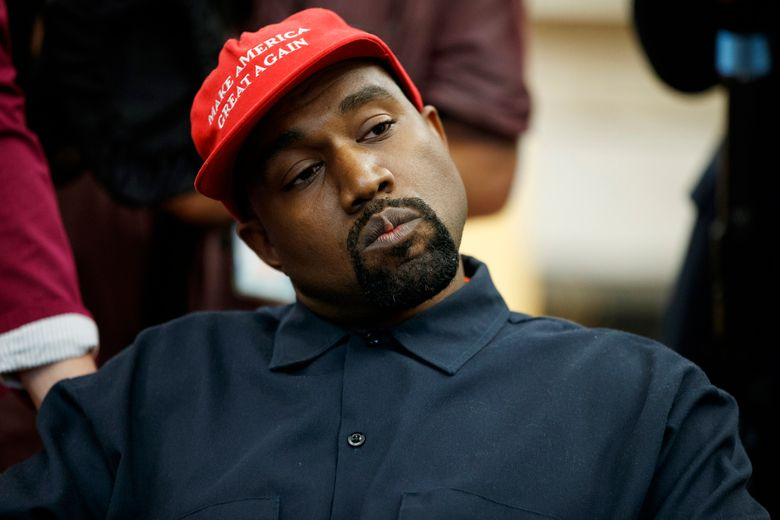 FILE – In this Oct. 11, 2018, file photo rapper Kanye West listens to a question from a reporter during a meeting in the Oval Office of the White House with President Donald Trump in Washington. On Sunday, Aug. 25, 2019, Kanye West hosted a Sunday Service in Ohio in support of those affected by the recent mass shooting. A large crowd gathered at the service in a park in Dayton. (AP Photo/Evan Vucci, File)