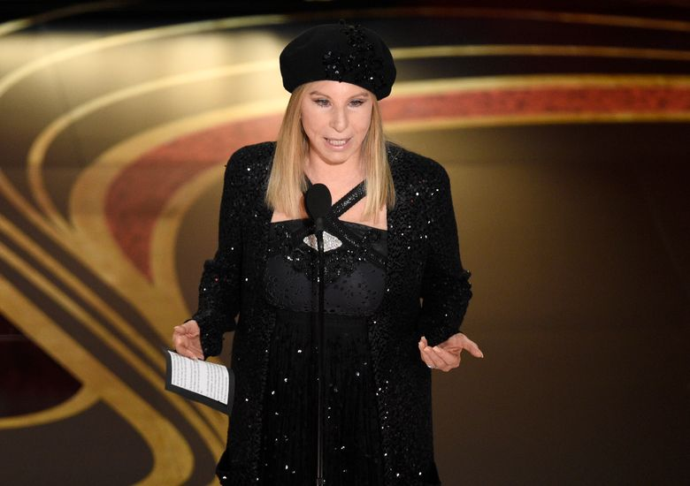 """FILE – In this Feb. 24, 2019 file photo, Barbra Streisand introduces """"BlacKkKlansman"""" at the Oscars at the Dolby Theatre in Los Angeles.  Streisand's return to New York City's Madison Square Garden in 13 years attracted political figures like Bill and Hillary Clinton as well as pop superstar Mariah Carey. Streisand performed a show-stopping concert Saturday night, Aug. 3 in front of feverish fans, who gave the iconic singer several standing ovations, including Carey, who showed up to her seat as Streisand ended her first song of the night. (Photo by Chris Pizzello/Invision/AP, File)"""