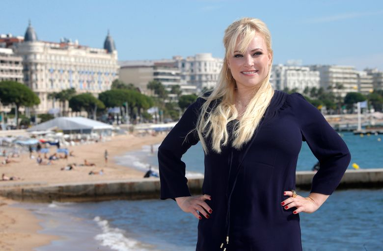 """FILE – In this Oct. 8, 2013, file photo,  Meghan McCain poses during a photocall at the 29th MIPCOM (International Film and Programme Market for TV, Video, Cable and Satellite) in Cannes, France.  McCain will share some thoughts about politics and her late father, Sen. John McCain, on an audiobook coming out next year. Audible.com announced Friday, Aug. 2, 2019 that McCain would offer a """"blueprint"""" for conservative politics while also drawing upon what she learned from her father, the war hero, Arizona Republican and 2008 presidential candidate. (AP Photo/Lionel Cironneau, File)"""