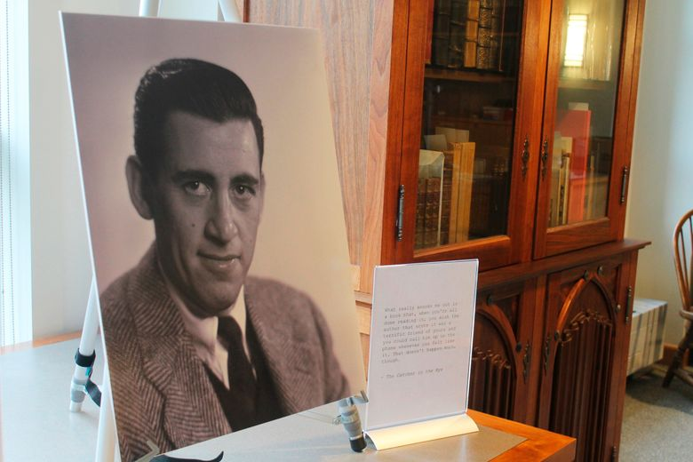 """FILE – In a Tuesday, Jan. 22, 2019 file photo, a previously unseen photo of author J.D. Salinger is displayed at the University of New Hampshire in Durham, N.H. 'The Catcher in the Rye' author is going digital The late J.D. Salinger is giving in to the digital revolution. Longtime Salinger publisher Little, Brown and Company says it's the first time that the entirety of Salinger's published work, including """"The Catcher and the Rye,"""" will be available as e-books. The electronic publication is happening Tuesday, August 13, 2019. (AP Photo/Holly Ramer, File)"""
