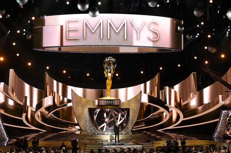 """FILE – This Sept. 18, 2016 file photo shows the main stage during the 68th Primetime Emmy Awards in Los Angeles. There will be no host at the ceremony honoring TV's best next month. Fox Entertainment CEO Charlie Collier said Wednesday, Aug. 7, 2019, that going host-less allows more time to salute departing shows, including """"Game of Thrones.""""  (Photo by Chris Pizzello/Invision/AP, File)"""