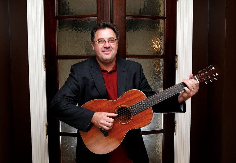 """FILE – In this Feb. 1, 2016 file photo, Vince Gill poses for a photo at his home in Nashville, Tenn. Gill doesn't hold back on weighty topics of regret, faith, his marriage and sexual abuse on his new record """"Okie"""" coming out on Aug. 23, 2019. The Grammy-winner admitted to breaking down in the studio as he sang a song for his wife, Amy Grant, but he said there's a lot of emotion tied up his songs, some of which he waited a lifetime to write and record. (Photo by Donn Jones/Invision/AP, file)"""