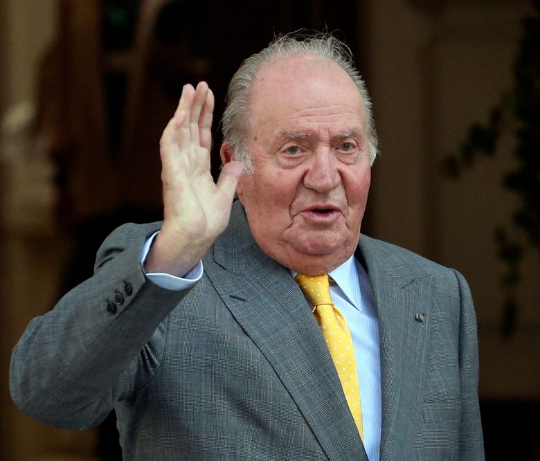 FILE – In this March 10, 2018, file photo, Spain's former monarch King Juan Carlos waves upon his arrival to the Academia Diplomatica de Chile, in Santiago where he met with President-elect Sebastian Pinera. Spain's former monarch, Juan Carlos I, has been admitted to hospital for a heart operation. The 81-year-old king emeritus will undergo the operation Saturday Aug. 24, 2019 in Madrid's Quiron clinic. (AP Photo/Esteban Felix, File)