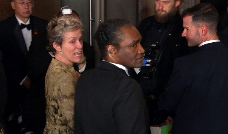 """FILE – This March 4, 2018 file image taken from video shows Oscar winner Frances McDormand, foreground left, walking into the Governors Ball next to Terry Bryant, center, the man accused of stealing her Academy Award in Los Angeles. McDormand won the best actress category for her role in """"Three Billboards Outside Ebbing, Missouri."""" On the day his trial was to begin, charges against Bryant have been dropped. Los Angeles County prosecutors said in court Tuesday, Aug. 20, 2019 that they were unable to proceed with the case against him, and a judge granted a defense motion to dismiss it. (AP Photo/Jeff Turner, file)"""