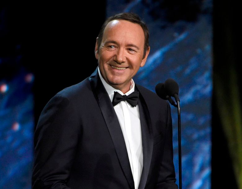 FILE – In this Oct. 27, 2017 file photo, Kevin Spacey presents the award for excellence in television at the BAFTA Los Angeles Britannia Awards in Beverly Hills, Calif.  Spacey has made his first public appearance since being accused of sexual assault, reading a poem about a worn-out boxer in a Rome museum. Standing next to a Greek bronze statue of a battered boxer in the National Roman Museum on Friday, Aug. 2, 2019, Spacey dramatically intoned Italian poet Gabriele Tinti's poem ''The Boxer,'' about a fighter left bleeding at ringside, cast aside despite previous glory. (Photo by Chris Pizzello/Invision/AP, File)