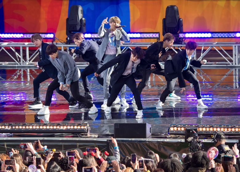 """FiLE – In this May 15, 2019, file photo, South Korean boy band BTS perform on ABC's """"Good Morning America at Rumsey Playfield/SummerStage in Central Park, in New York. The agency for K-pop superstars BTS says the singers will take an extended break from showbiz to rest and relax and """"enjoy the ordinary lives of young people in their 20s, albeit briefly."""" Big Hit Entertainment said a concert on Monday, Aug. 12, 2019, in Seoul was group's last scheduled event before the seven members go on """"vacations"""" for the first time since their 2013 debut. (Photo by Scott Roth/Invision/AP, File)"""