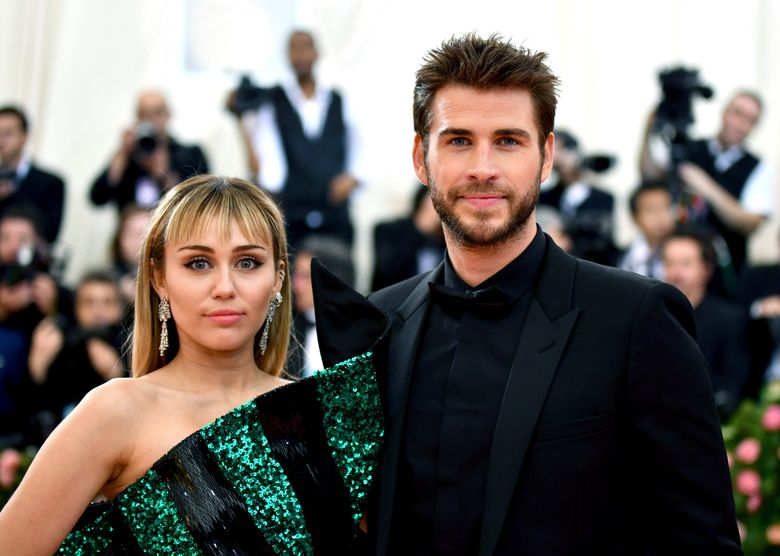 """FILE – In this May 6, 2019 file photo, Miley Cyrus, left, and Liam Hemsworth attend The Metropolitan Museum of Art's Costume Institute benefit gala celebrating the opening of the """"Camp: Notes on Fashion"""" exhibition in New York. Cyrus and Hemsworth have separated after less than a year of marriage. A representative for the singer said Saturday, Aug. 10 the pair decided a break was best while they focus on """"themselves and careers."""" Cyrus and Hemsworth, who starred in """"The Hunger Games"""" films, have been an on-and-off again couple for more than a decade. They married in December 2018.  (Photo by Charles Sykes/Invision/AP, File)"""