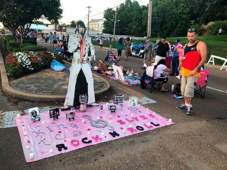 A street art display honoring Elvis Presley is shown at the candlelight vigil at Graceland that commemorates his death 42 years ago on Thursday, Aug. 15, 2019 in Memphis, Tenn. Presley fans flock every year to the Graceland tourist attraction for Elvis Week, a celebration of his life and career as a singer and actor. During the vigil, fans walk by Presley's grave at Graceland holding candles. (AP Photo/Adrian Sainz)