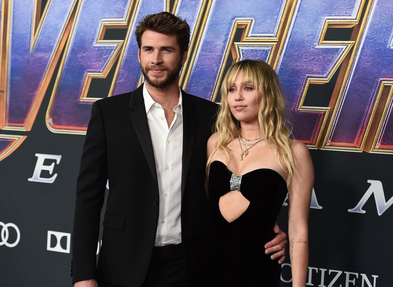 """FILE – In this Monday, April 22, 2019, file photo, Liam Hemsworth, left, and Miley Cyrus arrive at the premiere of """"Avengers: Endgame"""" at the Los Angeles Convention Center. Liam Hemsworth is seeking a divorce from Miley Cyrus after seven months of marriage. The 29-year-old Australian actor filed for the dissolution of his marriage to the 26-year-old American pop star in Los Angeles Superior Court on Wednesday, Aug. 21, 2019. (Photo by Jordan Strauss/Invision/AP, File)"""