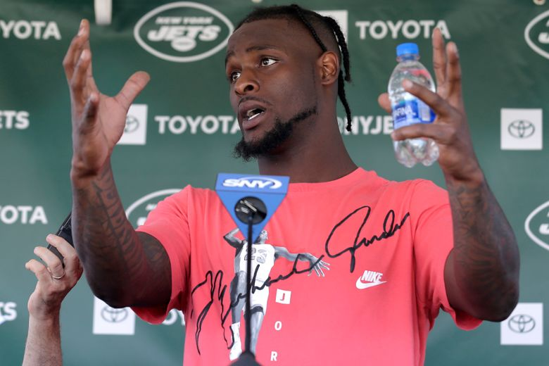 """FILE – In this July 25, 2019, file photo, New York Jets running back Le'Veon Bell speaks to reporters after a practice at the NFL football team's training camp in Florham Park, N.J. Bell was in fifth grade when he realized he couldn't shake music from his mind. """"That's when I really realized I loved music,"""" the star running back recalled in an interview with The Associated Press in the players' lobby in the New York Jets' facility.  (AP Photo/Seth Wenig, File)"""