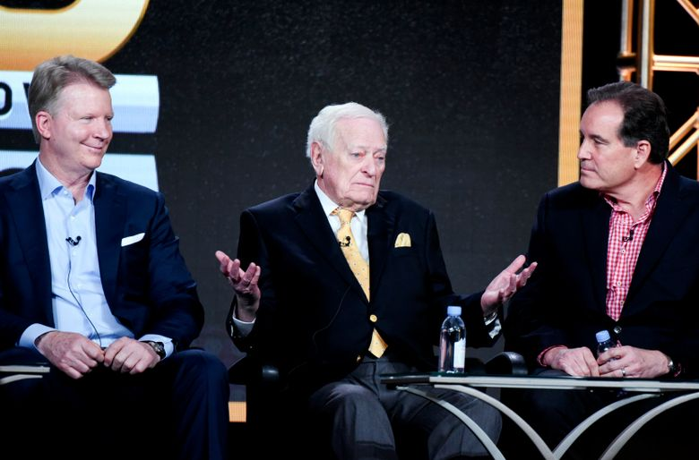 """FILE – In this Jan. 12, 2016, file photo, from left to right, sportscasters Phil Simms, Jack Whitaker and Jim Nantz participate in the """"CBS Sports"""" panel at the CBS 2016 Winter TCA in Pasadena, Calif.  Whitaker, whose Hall of Fame broadcasting career ranged from the first Super Bowl to Secretariat's Triple Crown to short essays from major sporting events, died Sunday, Aug. 18, 2019, CBS reported. The network said Whitaker died of natural causes in his sleep in Devon, Pa. He was 95. (Photo by Richard Shotwell/In vision/AP, File)"""
