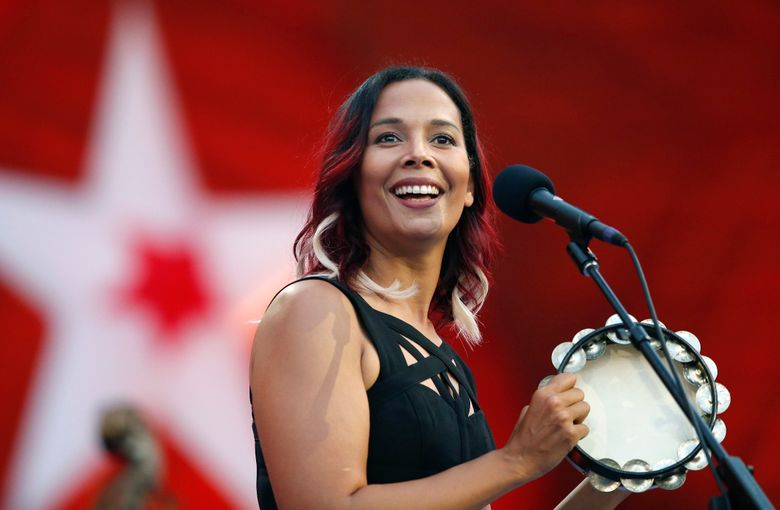 TAKES OUT REFERENCE TO PIONEERING COMPOSER – FILE – In this Tuesday, July 3, 2018, file photo, Rhiannon Giddens performs during rehearsal for the Boston Pops Fireworks Spectacular in Boston. Grammy-winning folk singer and musician Giddens and the late Frank Johnson, the leader of a 19th century black brass band, will be the first recipients of the inaugural Legacy of Americana Award, on Sept. 11, 2019, in Nashville, Tenn.  (AP Photo/Michael Dwyer, File)