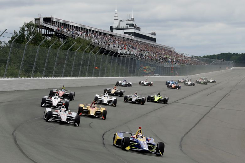 FILE – In this Aug. 19, 2018, file photo, Alexander Rossi (27) leads the field after a restart during the IndyCar auto race at Pocono Raceway in Long Pond, Pa. IndyCar and Pocono Raceway could be headed toward another split. The track has no deal for the open-wheel series to return for an eighth straight year in 2020, and another break could be on the horizon after Sunday's race. (AP Photo/Matt Slocum)