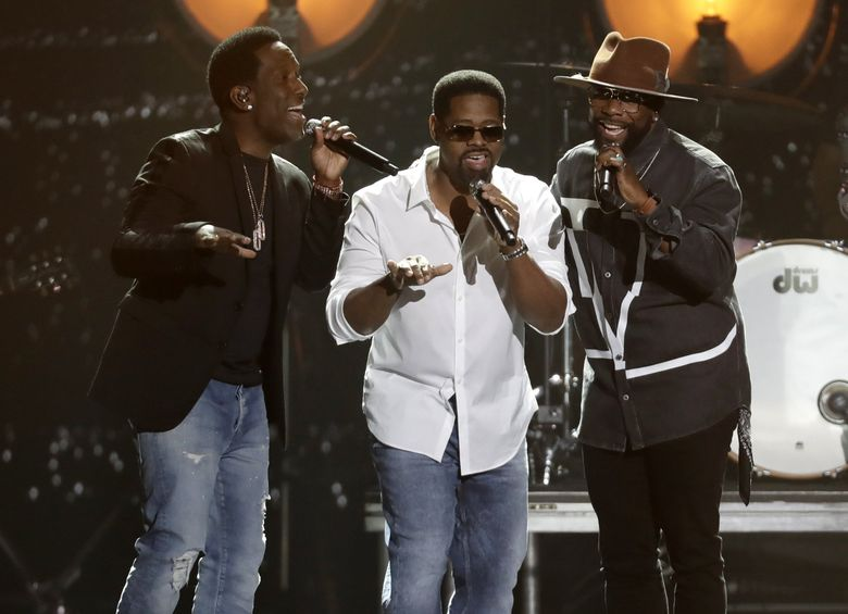 Boyz II Men (with, from left, Shawn Stockman, Nathan Morris and Wanya Morris) perform at the CMT Music Awards on June 5, 2019, at the Bridgestone Arena in Nashville, Tenn. (Mark Humphrey / AP)