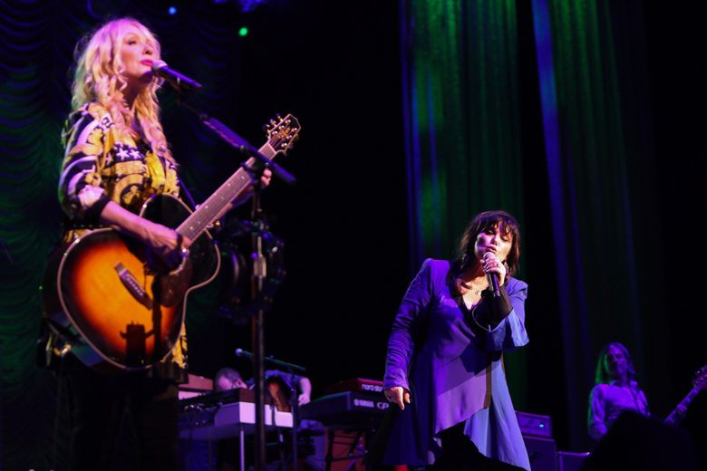 Heart brought their Love Alive tour to the Tacoma Dome Wednesday. Sisters Nancy, left, and Ann, seen here during a previous tour stop, are playing their first run together in three years. (Kimberly Adamis, file)