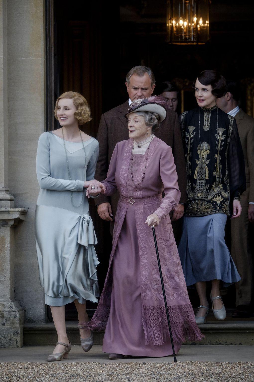 "Laura Carmichael as Edith Crawley, left, Maggie Smith as Violet Crawley, Hugh Bonneville as Robert Crawley, Allen Leech as Tom Branson and Elizabeth McGovern as Cora Crawley in the ""Downton Abbey"" movie. (Jaap Buitendijk / Focus Features)"