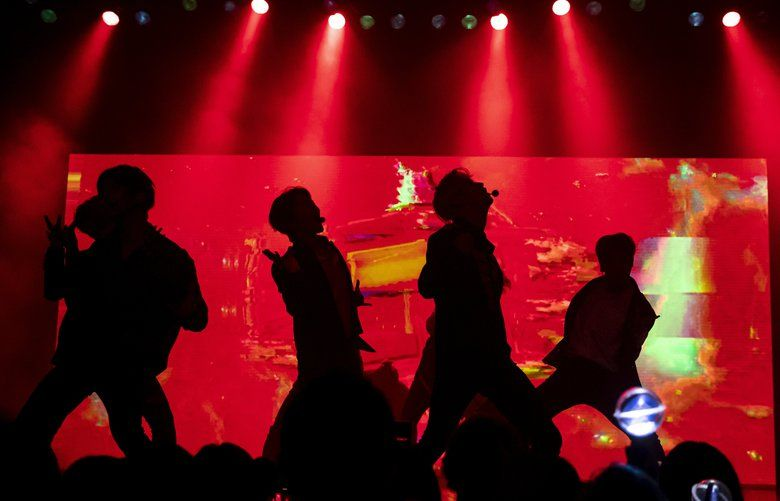The K-Pop band Pentagon, a nine-member group from South Korea, performs at the Moore Theatre in Seattle Tuesday, Sept. 10, 2019. (Erika Schultz / The Seattle Times)