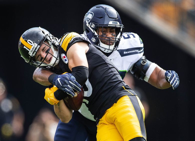 K.J. Wright hits Pittsburgh receiver Ryan Switzer immediately after he makes the reception holding him to a 1-yard reception in the 3rd. (Dean Rutz / The Seattle Times)