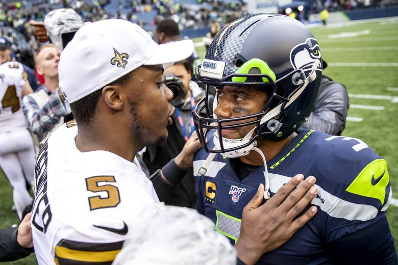 Saints quarterback Teddy Bridgewater greets Seahawks quarterback Russell Wilson after the Seahawks' 33-27 loss to the New Orleans Saints at CenturyLink Field. (Dean Rutz / The Seattle Times)