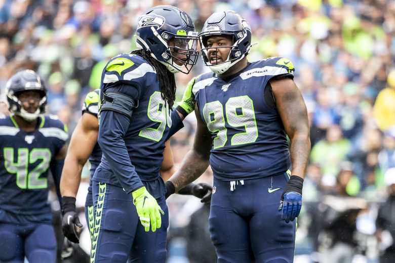 """Seahawks defensive end Ezekiel """"Ziggy"""" Ansah talks with defensive tackle Quinton Jefferson in his debut game for the Seattle Seahawks as they take on the New Orleans Saints at CenturyLink Field in Seattle Sunday September 22, 2019.  211566 (Dean Rutz / The Seattle Times)"""