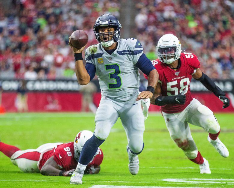 Seahawks quarterback Russell Wilson scrambles last Sunday. (Mike Siegel / The Seattle Times)