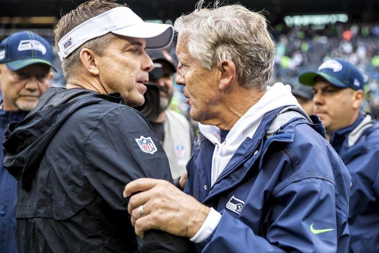 Saints head coach Sean Payton greets Seahawks head coach Pete Carroll after the game Sunday at CenturyLink Field. (Dean Rutz / The Seattle Times)