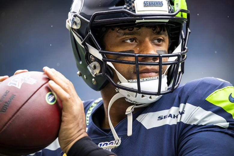Seahawks quarterback Russell Wilson warms up before the Seattle Seahawks take on the New Orleans Saints at CenturyLink Field in Seattle Sunday September 22, 2019.  (Dean Rutz / The Seattle Times)