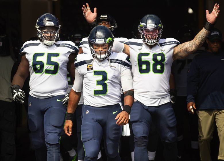 Russell Wilson leads his team out of the tunnel for the Seahawks' game against the Steelers at Heinz Field in Pittsburgh. (Dean Rutz / The Seattle Times)