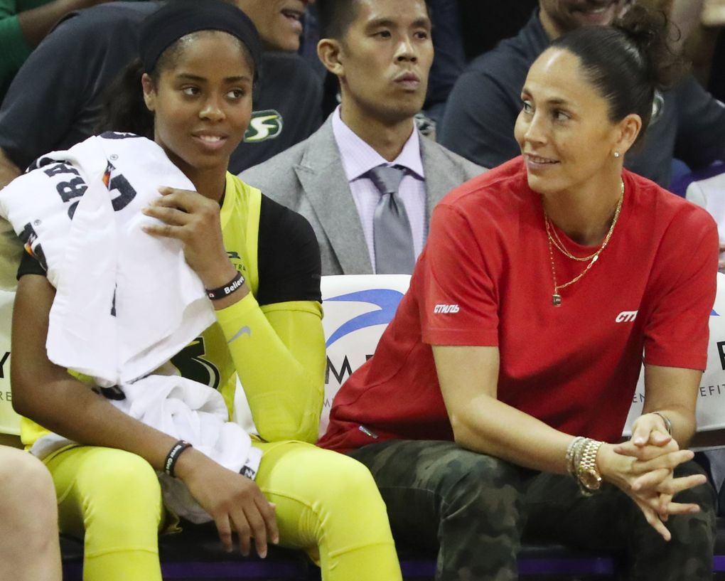 Seattle Storm guards Jordin Canada, left, and Sue Bird watch the game against Atlanta during the second half, Sunday, Sept. 1, 2019 in Seattle. 211361 (Ken Lambert / The Seattle Times)