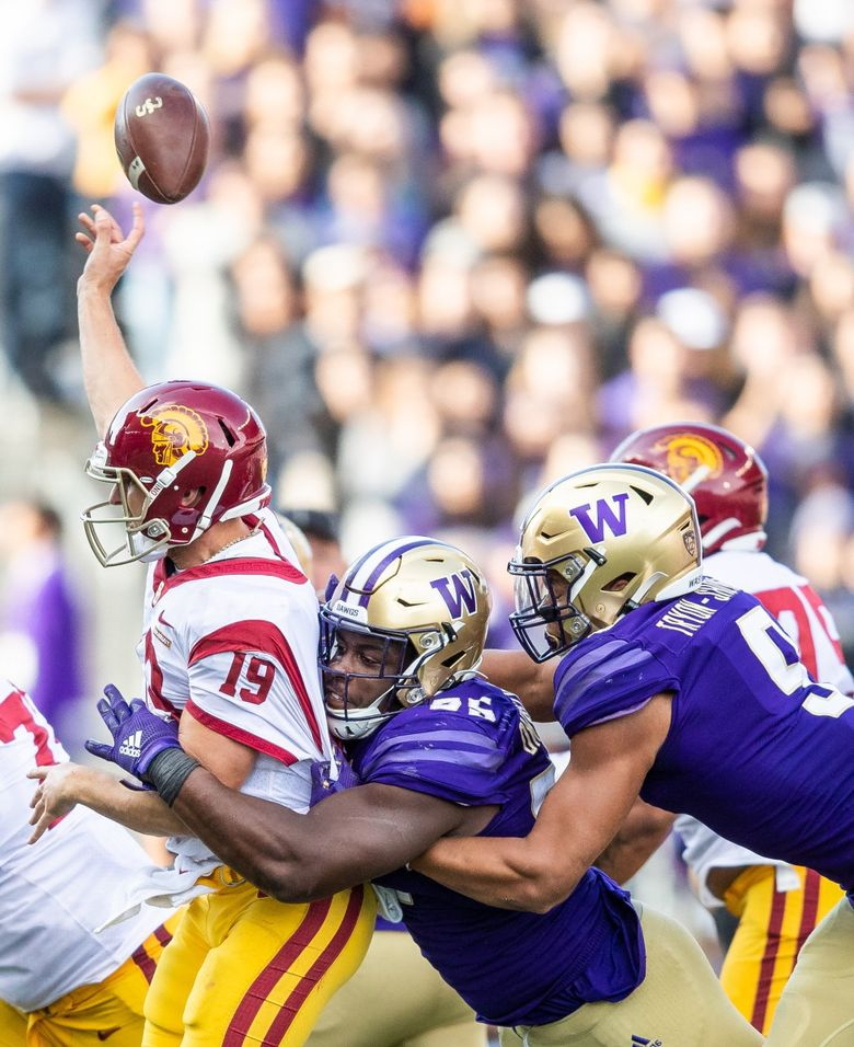 Washington Huskies defensive lineman Levi Onwuzurike (95) takes down USC quarterback Matt Fink as he makes an illegal and incomplete pass during the second half Saturday. (Andy Bao / The Seattle Times)