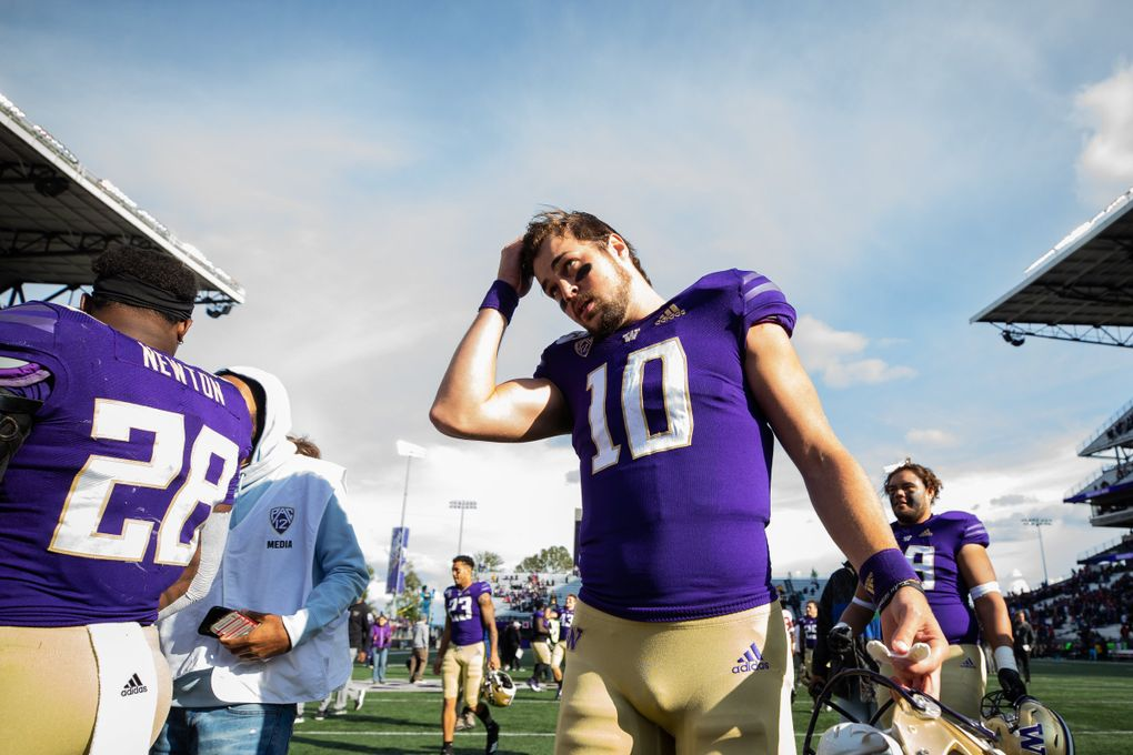 Washington Huskies quarterback Jacob Eason (10) walks off the field after the game Saturday. (Andy Bao / The Seattle Times)