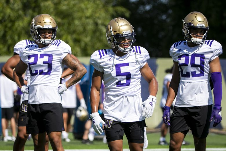 Defensive backs Myles Bryant, middle, Brandon McKinney, left, and Julius Irvin, right, at training camp in August. (Bettina Hansen / The Seattle Times)