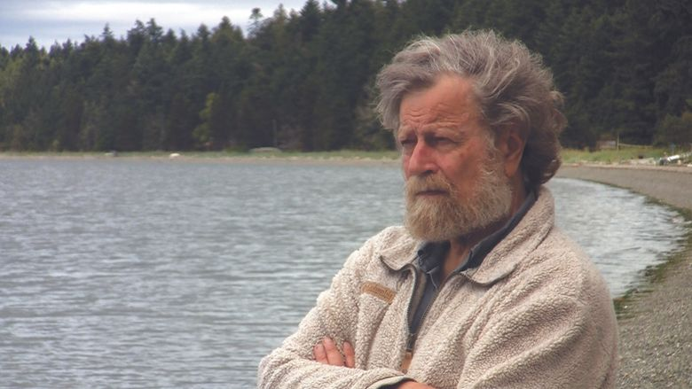 """A still from Michael Stillwater's documentary film """"Shining Night: A Portrait of Composer Morten Lauridsen"""" shows the composer on Waldron Island. (Michael Stillwater)"""