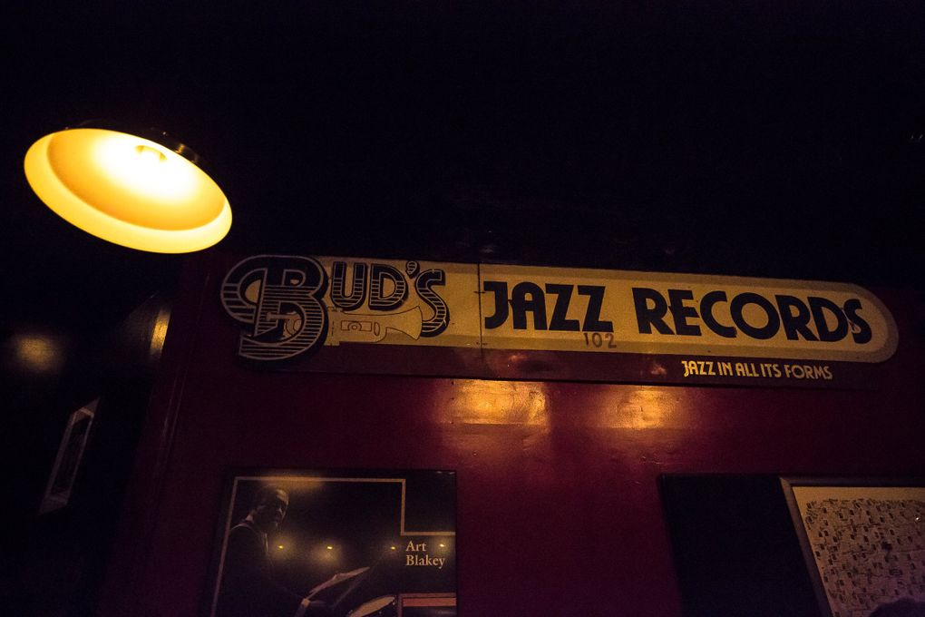 Mementos from Seattle's jazz scene, including the huge wooden sign that once advertised Bud's Jazz Records in Pioneer Square, decorate the walls of Tula's Restaurant and Jazz Club. (Rebekah Welch / The Seattle Times)