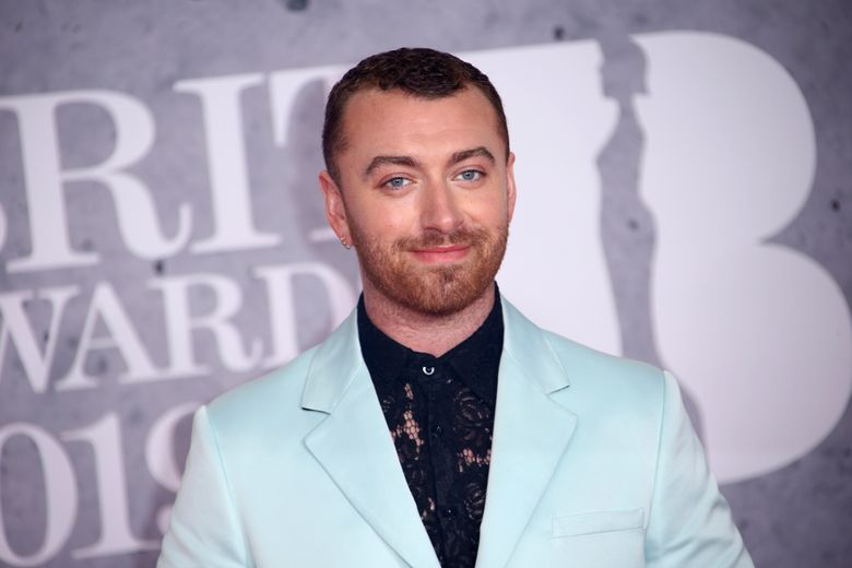 """File-This Feb. 20, 2019, file photo shows singer Sam Smith posing for photographers upon arrival at the Brit Awards in London. The Oscar-winning pop star has declared their pronouns """"they/them"""" on social media after coming out as non-binary in their """"lifetime of being at war with my gender."""" The English """"Too Good at Goodbyes"""" singer said Friday, Sept. 13, 2019, they've decided to """"embrace myself for who I am, inside and out …"""" (Photo by Joel C Ryan/Invision/AP, File)"""