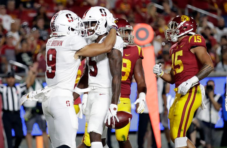 Stanford wide receiver Connor Wedington (5) celebrates his touchdown catch with Osiris St. Brown (9) during the first half a football game against USC on Sept. 7, 2019, in Los Angeles. (AP Photo/Marcio Jose Sanchez)