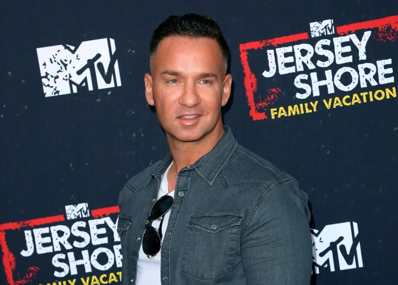 """FILE – In this March 29, 2018 file photo, Mike """"The Situation"""" Sorrentino arrives at the """"Jersey Shore Family Vacation"""" premiere in Los Angeles. Sorrentino has regained his freedom. The reality television star's publicist said he was released from prison in Otisville, New York, Thursday morning, Sept. 12, 2019, after serving about eight months for tax evasion. (Photo by Willy Sanjuan/Invision/AP, File)"""