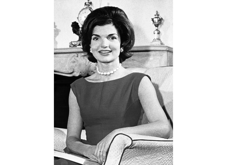 """FILE – This March 27, 1960 photo shows Jacqueline Kennedy posing in the living room of her residence in Washington, D.C. """"Camera Girl: How Miss Bouvier Used Imagination & Subversion To Invent Jackie Kennedy,"""" a book on Kennedy's early years as a columnist, is scheduled to come out in Spring 2021, Gallery Books announced Thursday, Sept. 12. (AP Photo, File)"""
