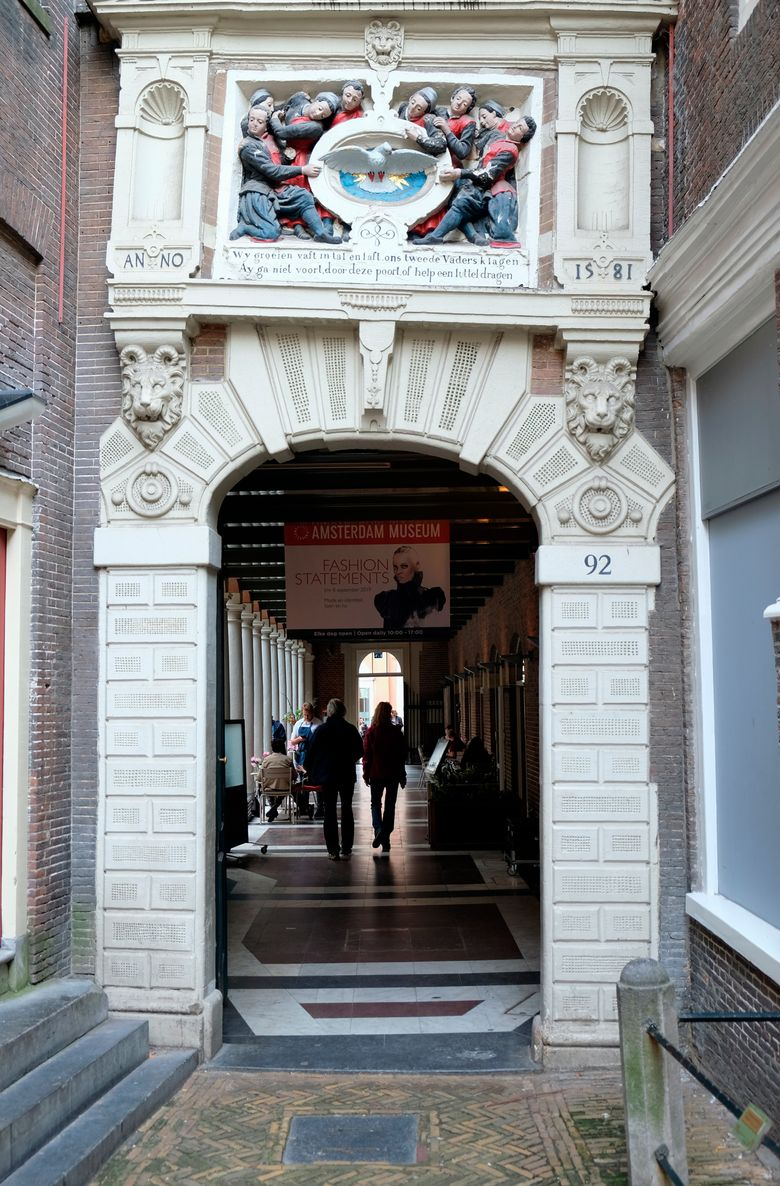 """Visitors enter the Amsterdam Museum in Amsterdam, Friday, Sept. 13, 2019. A museum in Amsterdam is facing criticism for its decision to stop using the term """"Golden Age"""" to describe the 17th century, when the Netherlands was a global mercantile, military and artistic superpower. Amsterdam Museum curator Tom van der Molen says the term is strongly linked to national pride over prosperity and peace but """"ignores the many negative sides of the 17th century, such as poverty, war, forced labor and human trafficking."""" (AP Photo/Michael Corder)"""