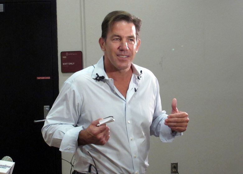 """FILE – This July 14, 2014 file photo shows former South Carolina Treasurer and reality TV star Thomas Ravenel talking to reporters after applying to run as an independent candidate for the U.S. Senate seat held by Lindsey Graham at the state Election Commission headquarters in Columbia, S.C. Ravenel has been fined $500 after taking a plea deal to charges he assaulted a former nanny. He was initially charged with misdemeanor second-degree assault and battery after the nanny said the former """"Southern Charm"""" star dropped his pants and fondled her at his Charleston home in January 2015. (AP Photo/Jeffrey Collins, File)"""